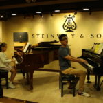 Piano students visit Tom-Lee Steinway & Sons Hall