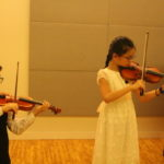 Reflections from the Performers:  Naphat and Nithit, Book 3 Recital